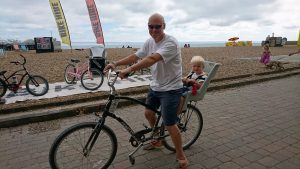 Child seat and bike on beach
